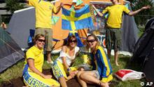 Swedish Soccer fans relax at the World Cup tent camp in front of the Dortmund Airport, Bielefeld, Germany, Friday June 9, 2006. Sweden will face Trinidad and Tobago in their first World Cup match, Saturday June 10. (AP Photo/Peter Brenneken)