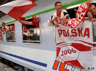 Polish soccer fans wave flags and scarves out of the windows during a short stop of a extra train going from Warszaw to Gelsenkirchen, at the German-Polish border Friday morning, June 09, 2006 in the station of Frankfurt (Oder). In Gelsenkirchen Friday night the Polish national team will play its first match of FIFA Soccer World Championship 2006 against Ecuador. (AP Photo/Sven Kaestner)