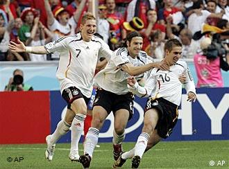 Germany's Philipp Lahm (right) and Thorsten Frings (center) both scored goals