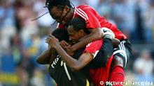 Shaka Hislop, Dennis Lawrence and Brent Sancho (L-R) from Trinidad and Tobago react at the end of the group B match of 2006 FIFA World Cup between Trinidad and Tobago and Sweden in Dortmund on Saturday, 10 June, 2006. The match ended 0:0. DPA/ACHIM SCHEIDEMANN +++ Mobile Services OUT +++ Please refer to FIFA's Terms and Conditions. +++(c) dpa - Report+++