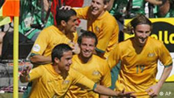 Australia's Tim Cahill (4) celebrates his goal with his teammates during the second half of their World Cup Group F soccer match against Japan in Kaiserslautern, Germany, Monday, June 12, 2006.