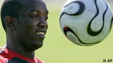 Trinidad and Tobago's Dwight Yorke heads for a ball during World Cup soccer training, Tuesday, June 13, 2006, in Rotenburg, nothern Germany. Trinidad and Tobago play in Group B, with England, Sweden and Paraguay. (AP Photo/Kai -Uwe Knoth)