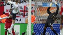 England's Peter Crouch, left, heads the ball past Trinidad and Tobago's Shaka Hislop, right, to score the opening goal during their World Cup Group B soccer match in Nuremberg, Germany, Thursday, June 15, 2006. Other teams in the group are Paraguay and Sweden. (AP Photo/Matt Dunham) ** MOBILE/PDA USAGE OUT **