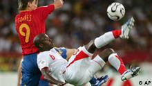 Tunisia's Hatem Trabelsi, right, kicks the ball during the Spain v Tunisia Group H soccer match at the World Cup Gottlieb-Daimler stadium in Stuttgart, Germany, Monday, June 19, 2006. On left is Spain's Fernando Torres. The other teams in Group H are Saudi Arabia and Ukraine. (AP Photo/Daniel Maurer) ** MOBILE/PDA USAGE OUT **