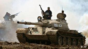 Kurdish peshmerga troops drive their T-54/55 soviet made tanks during an exercise near Halabja, south of Sulaimaniyah, northern Iraq