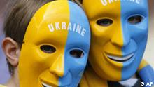 Two fans for the the Ukraine wear masks prior to the start of the Ukraine v Tunisia Group H World Cup soccer match at the Olympic Stadium, Berlin, Germany, Friday, June 23, 2006. The other teams in Group H are Spain and Saudi Arabia. (AP Photo/Jasper Juinen) ** MOBILE/PDA USAGE OUT **