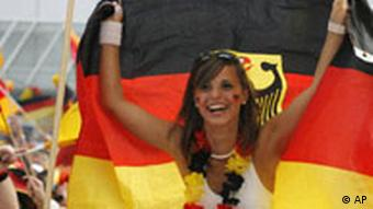 A female German soccer fan waving a flag