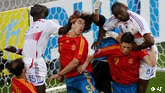 Spain goalie Iker Casillas (1) punches the ball out ahead of teammates Mariano Pernia (3), Carlos Puyol (5) and Fernando Torres (9) as France's Lilian Thuram (15) and Patrick Vieira (4) battle for a rebound during the first half of the Spain vs France, Round of 16, World Cup 2006, soccer match at World Cup stadium in Hanover, Germany, on Tuesday, June 27, 2006.