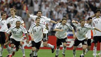 German players react after goalie Jens Lehmann (1) made a save to win the game in the shootout of the quarterfinal World Cup soccer match between Germany and Argentina at the Olympic Stadium in Berlin, Germany, Friday, June 30, 2006.