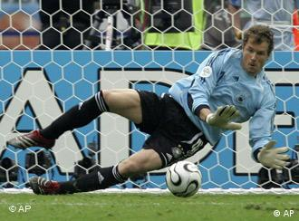 Germany goalie Jens Lehmann (1) makes a save on the penalty kick by Argentina's Roberto Ayala (2) during the shootout in the quarterfinal World Cup soccer match between Germany and Argentina at the Olympic Stadium in Berlin, Germany, Friday, June 30, 2006. Germany won the game, 4-2 on penalty kicks.