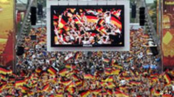 German soccer fans celebrate during the World Cup quarterfinal match between Germany and Argentina at the 'Fan Mile' a public viewing zone in Berlin on Friday, June 30, 2006.
