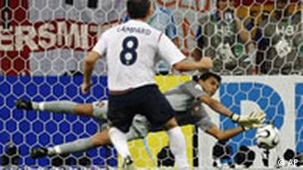 Portugal's goalkeeper Ricardo makes a save on a penalty kick by England's Frank Lampard during the quarterfinal World Cup soccer match between England and Portugal in Gelsenkirchen, Germany, Saturday, July 1, 2006.