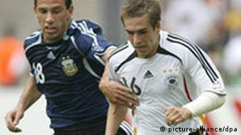 Lahm fights for the ball with Argentina's Maxi Rodriguez at the 2006 World Cup
