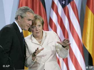President Bush confers with German Chancellor Angela Merkel after a press conference in Germany in 2006