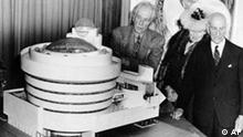 Architect Frank Lloyd Wright, left, looks over his spiral-shaped building for a proposed Guggenheim Museum with arts patron Solomon R. Guggenheim, right, and artist Baroneness Hilla Rebay, director of proposed museum, in New York City, Sept. 20, 1945. (AP Photo)