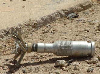 An unexploded US cluster bomb