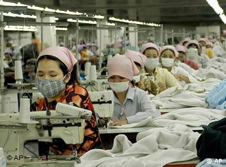 Cambodian garment factory workers toil at the W&D garment factory, just southeast of Phnom Penh