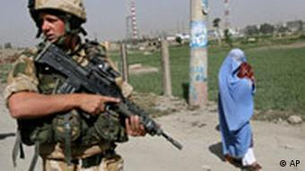 A British soldier with NATO, patrols in Kabul, Afghanistan