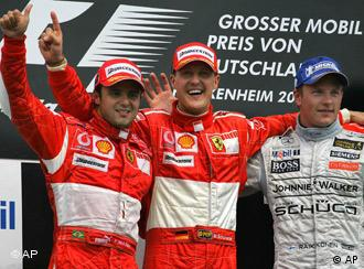 Brazil's Ferrari driver Felipe Massa, Germany's Ferrari driver Michael Schumacher and Finland's McLaren Mercedes driver Kimi Raikkonen, from left, celebrate during the winner's ceremony of the Formula One Grand Prix of Germany at the Hockenheimring circuit in Hockenheim, southern Germany, Sunday July 30, 2006.
