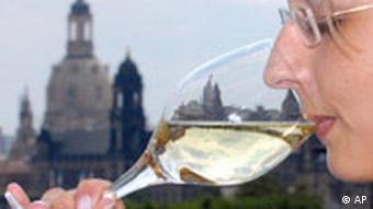 Woman drinking wine with Dresden in background