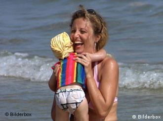 Mother holding her child at the beach