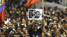 A man holds up a photograph of revolutionary hero Ernesto Che Guevara and Cuban leader Fidel Castro during a concert in honor of Castro in Havana, Cuba, Saturday, Aug.12, 2006. An ailing Fidel Castro turns 80 on Sunday amid official reports he is walking and talking again, and with his closest ally in Latin America, Venezuelan President Hugo Chavez, headed to Havana to visit his close friend and political ally in Havana. (AP Photo/ Javier Galeano)