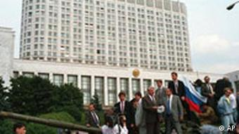 Boris Yeltsin, president of the Russian Federation, makes a speech from atop a tank in front of the Russian parliament building in Moscow, U.S.S.R., Monday, Aug. 19, 1991. Yeltsin called on the Russian people to resist the communist hardliners who ousted Soviet President Mikhail Gorbachev in the Soviet coup. (AP Photo)