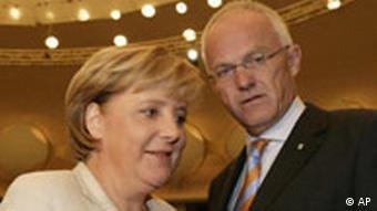 North Rhine Westphalia Premier Juergen Ruettgers with German Chancellor Angela Merkel