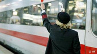 Deutsche Bahn conductor holding a signal on the tracks