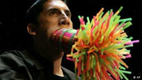Marco Hort sets record with 259 straws stuffed in his mouth