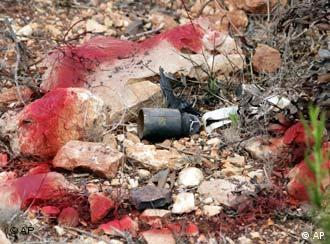 A cluster bomb used by Israel in Lebanon is marked by red painting on the Lebanon-Israeli border road near the southern Lebanese village of Naqura in August 2006
