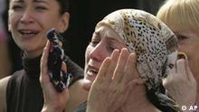 Women weep during ceremonies to remember the 333 people who died in Russia's worst terrorist attack, in the gymnasium of Beslan's School No. 1, southern Russia, Friday, Sept.1, 2006. Children, weeping parents and somber-faced officials marked the second anniversary of Russia's worst terrorist attack Friday, attending tearful ceremonies at the burnt-out shell of Beslan's School No. 1, where 333 staff, students and other adults died. (AP Photo/Sergei Grits)