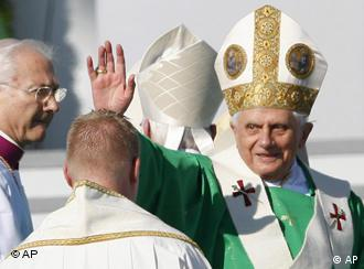 Hello, goodbye--Pope Benedict XVI waves to crowds before a mass in Munich on Sunday