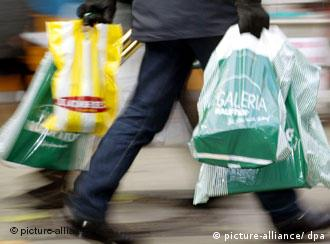 A person carrying stuffed shopping bags