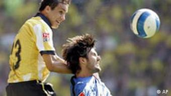 Dortmund's Philipp Degen from Switzerland, left, fights for the ball with Hamburg's Raphael Wicky from Switzerland during German first division soccer match between Borussia Dortmund and Hamburger SV at the Signal Iduna Park Stadium in Dortmund, Germany, Saturday, Sept. 16, 2006.