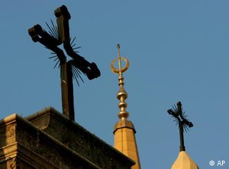 An Islamic symbol between crosses on top of a church and minaret