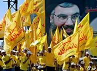 Lebanese and Palestinian demonstrators hold flags of the Hezbollah, Lebanon and Palestine