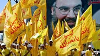 Poster of Hasan Nasrallah, Hezbollah leader, and Hezbollah flags