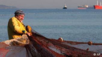 A Bulgarian fisherman pulls in his net on the Black Sea