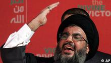 Hezbollah leader Sheik Hassan Nasrallah gestures as he delivers a speech to his supporters during a Hezbollah victory over Israel rally, in Beirut's bombed-out suburbs, in Lebanon, Friday, Sept. 22, 2006. In his first public appearance since the start of his group's summertime war with Israel, Nasrallah has said his group today possesses more than 20,000 rockets, and that a beefed-up U.N. peacekeeping force will not hurt the guerrillas' arsenal. (AP Photo/Hussein Malla)
