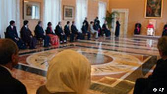 In this photo provided by the Vatican newspaper L'Osservatore Romano, Pope Benedict XVI, background in red and white, meets with Muslim diplomats and members of the Arab League, at Castel Gandolfo, Pope Benedict XVI's summer residence outside Rome, Monday, Sept. 25, 2006. Pope Benedict XVI told Muslim diplomats Monday that our future'' depends on good relations between Christians and Muslims as he sought to put to rest anger over his recent remarks about Islam and violence. (AP Photo/Plinio Lepri)