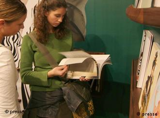 Two women looking at a book