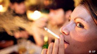 Woman smokes in a restaurant