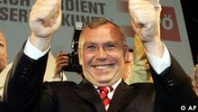 Top candidate of the Austrian Social Democrats Alfred Gusenbauer celebrates when arriving at their headquarters in downtown Vienna, on Sunday, Oct. 1, 2006, after the Austrian national elections. Election results show Austria's opposition Social Democrats with a 1,4 % lead over the ruling People's Party OEVP. (AP Photo/Hans Punz)