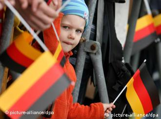 A young girl surrounded by German flags