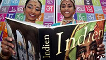 Two Indian women read a book about their country