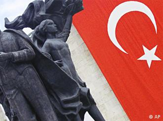 A statue of modern Turkey's founder, Mustafa Kemal Ataturk, is seen next to a Turkish flag