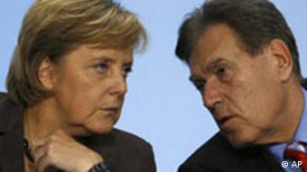 Angela Merkel and energy minister Michael Glos, speaking at an energy conference