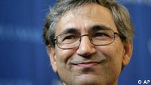 Turkish novelist Orhan Pamuk appears at a news conference in New York, Thursday, Oct. 12, 2006. Pamuk, an international symbol of literary and social conscience, whose poetic, melancholy journeys into the soul of his native Turkey have brought him the many blessings and burdens of public life, won the Nobel literature prize Thursday. (AP Photo/Seth Wenig)