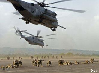 In this photo released by the United States Marine Corps, U.S. Marines and sailors from Battalion Landing Team 1st Battalion, 5th Marine Regiment of the 31st Marine Expeditionary Unit, conduct a long range helicopter-borne raid at Basa Air Base, Pampanga province north of Manila, Philippines on Sunday Oct. 15, 2006. The raid was executed with the assistance from members of the Philippine Air Force as part of the annual bilateral training exercises dubbed Talon Vision and Amphibious Landing Exercise (PHIBLEX) FY 2007 which officially began Monday. (AP Photo/U.S. Marine Corps, Staff Sgt. Ricardo Morales)